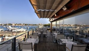 Overlooking the harbour and bay of Portocolom from restaurant Sa Llotja